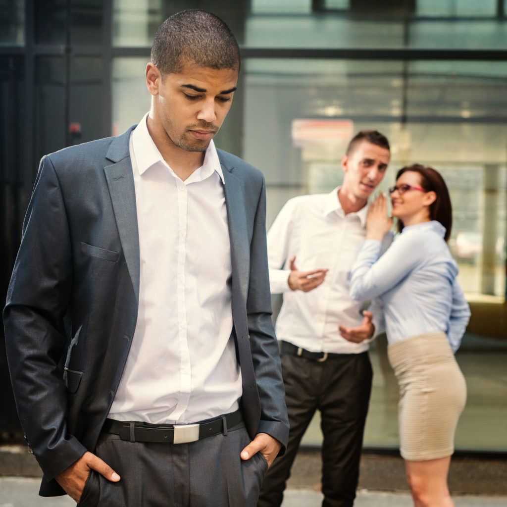 Gossip people in front of their office, handsome businessman portrait and racism gossip out of focus in background.