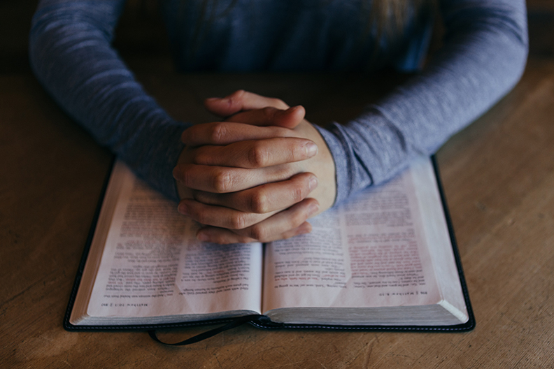 Religious Person's Hands on Bible