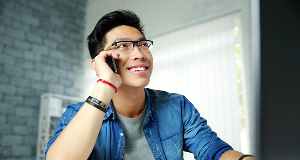 Happy Young Adult on Phone 2