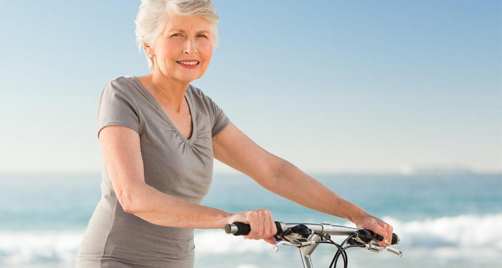 Old Woman on Bike Near Ocean (not cropped)