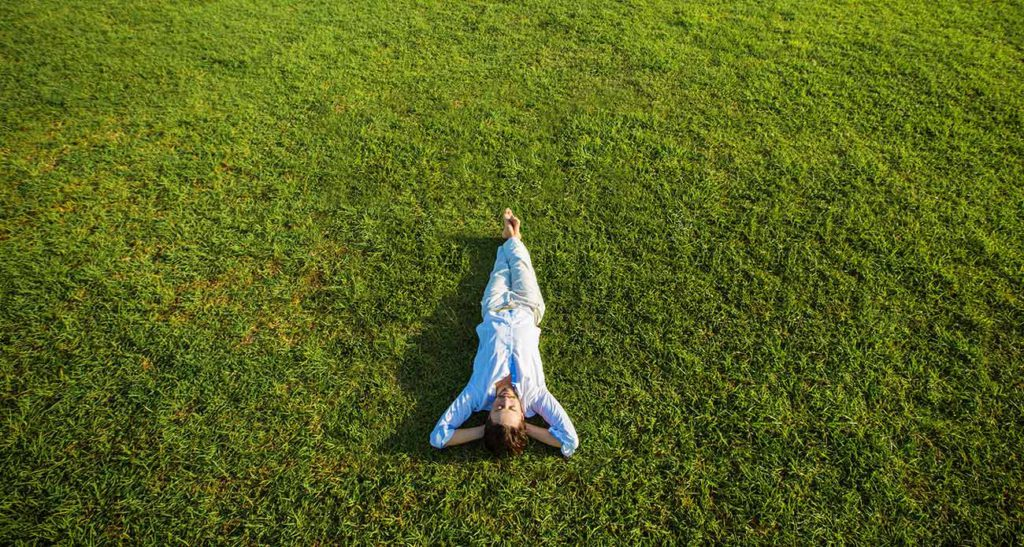 Person Lying Relaxed on Grass