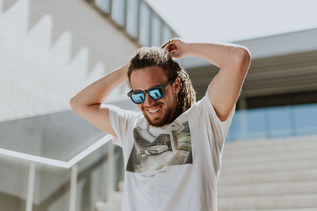 Content Man With Dreads Smiling