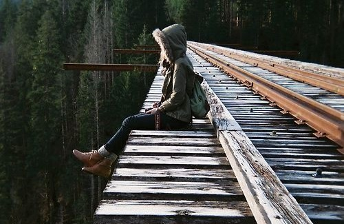 Girl Contemplating Suicide Sitting on Bridge